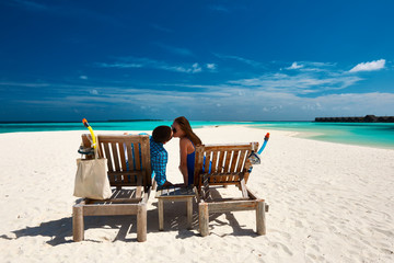 Couple relax on a beach at Maldives