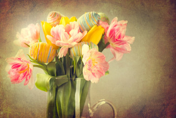 Easter. Tulip flowers bouquet decorated with colourful eggs