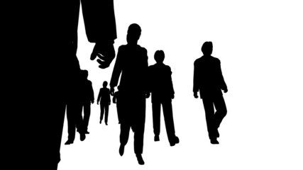 Silhouette of several people moving forward