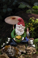 Gnomes in forest with mushroom and gold nugget