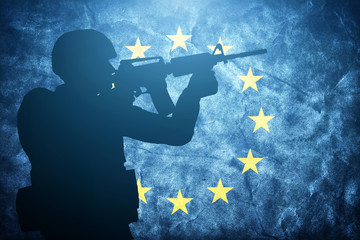 Soldier on grunge European Union flag. Army, military of Europe
