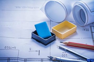 composition of pencil compass eraser rolled blueprints
