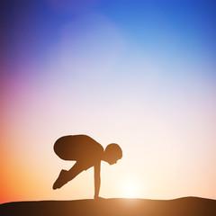 Woman in crane pose yoga pose meditating at sunset. Zen