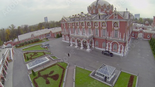 poster of Man in suit walks to edifice of Petrovsky Travelling Palace
