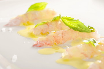 Delicious marinated shrimps with olive oil and lemon sauce