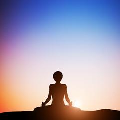 Woman in lotus yoga pose meditating at sunset. Zen