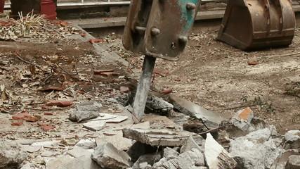 Loader Excavator Cracking Concrete