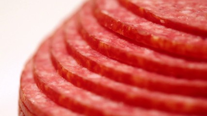 Sliced and laid out terraces circles revolve salami sausage