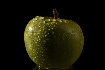 A wet green macro apple with water drops