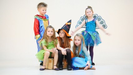 Five children in costumes isolated on white