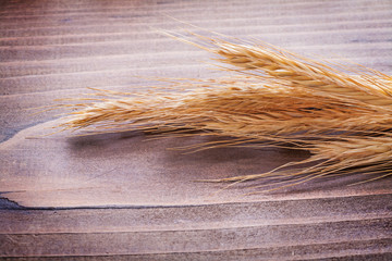 ears of wheat on vintage wooden board food and drink concept