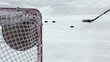 Постер, плакат: Hockey player shoots several pucks to targets in gate closeup