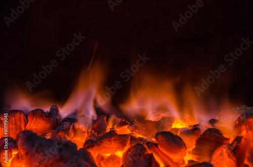 Leinwanddruck Bild Hot coals in the fire