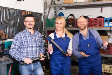 Auto service crew near tools