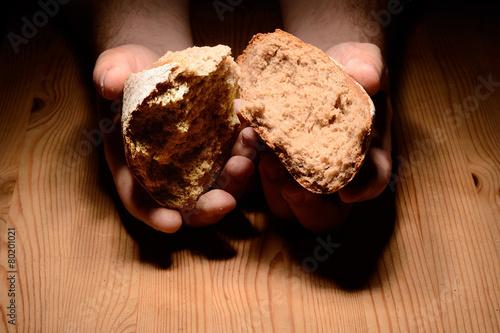 Leinwanddruck Bild Brot brechen