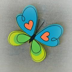 Bunte Schmetterling auf Holz