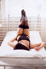 Boudoir morning of a sexy lady in lingerie in bed