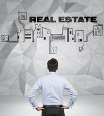 businessman looking to real estate