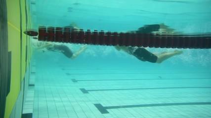 Sportswomen touch border and make u-turn underwater