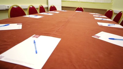 Rview conference room with oval table and red carpet on floor