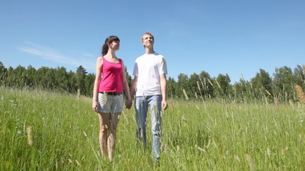 guy with girl to hold hands and smile to sun
