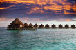 Lodges over water at the time sunset. Maldives...
