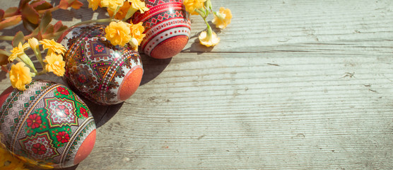 Easter eggs on wooden table background closeup