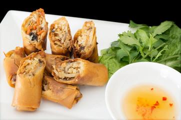 Vietnamese vegeratian egg rolls, cha gio chay on black backgroun