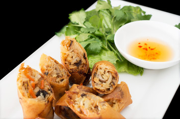 Vietnamese vegeratian egg rolls, cha gio chay on black backgroun