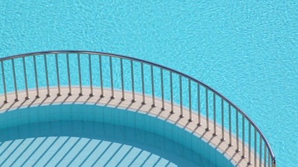 Two swimming pools and separating ledge with steel handrails