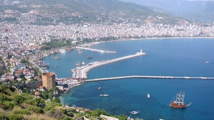 Ships come into port which settled down on bank of Alanya, time lapse