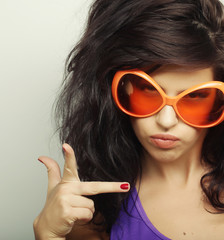 young woman with big orange sunglasses