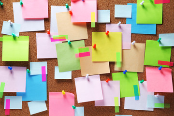 Image of colorful sticky notes on cork bulletin board