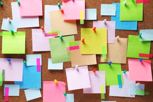 Leinwanddruck Bild Image of colorful sticky notes on cork bulletin board