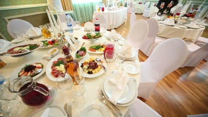 hall with tables and chairs with delicious food in restaurant