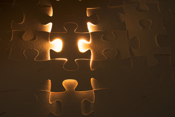 Missing jigsaw puzzle piece with light glow, business concept