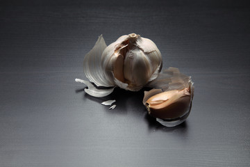 Image of garlic on black wooden table