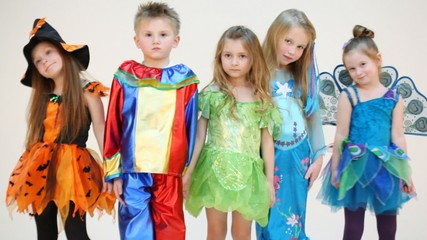 Five children in costume together standing for picture isolated