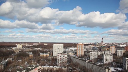 a daytime blue sky and roofs of apartment buildings (further)