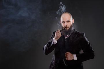 Bald bearded man in a suit