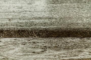 Rain fall on the road.