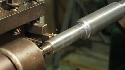 Lathe machining industrial shaft peeling, 60 FPS.