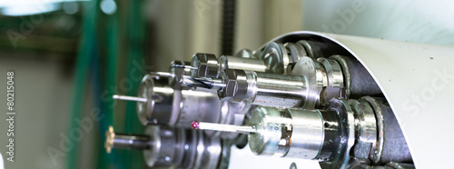 Rotating head with tools at CNC lathe in workshop - 80215048