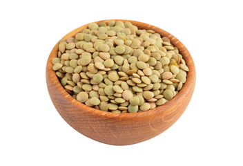 Green lentil in wooden bowl, isolated on white background