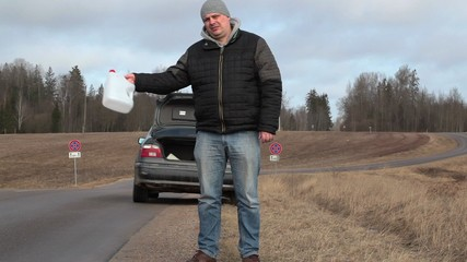 Man with empty can try to stop car