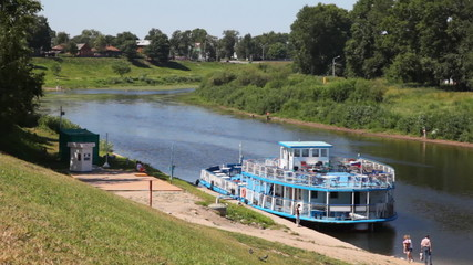 walking ship with Russian flag at river bank Vologda
