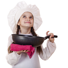Smiling little girl in cook hat with frying pan