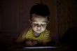 kid with tablet in the dark - 80218816