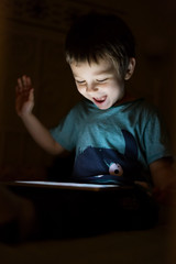 kid with tablet in the dark