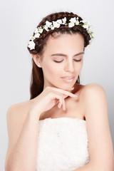 Young bride in wedding dress, studio shot